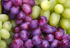 green and rose grapes background