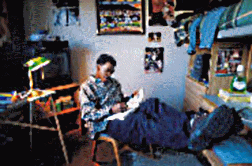 Image of Student Reading in Dorm Room