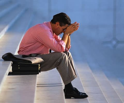 Businessman Thinking on Steps
