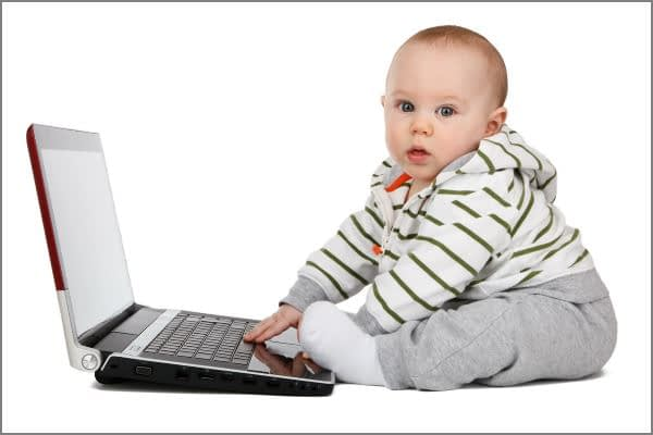 Baby Playing on Laptop Computer