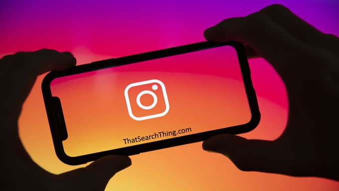 An instagram logo on the screen of a smartphone