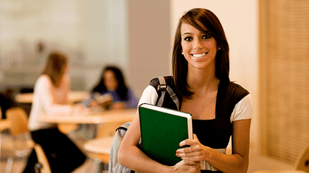 college-student-holding-books-smiling
