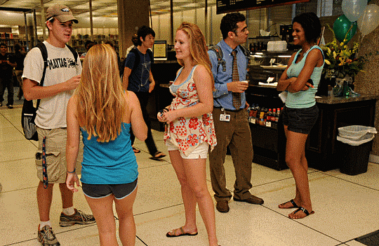 college-students-standing-around-talking