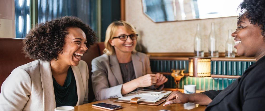 Women Laughing While Meeting