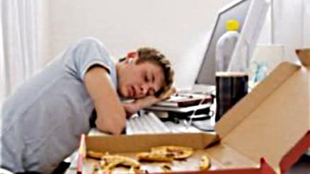 Image of Student Sleeping in Dorm Room