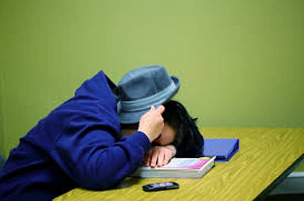 College Student Asleep in Class